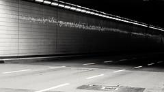 Towards the dark (frankdorgathen) Tags: street road traffic wall underpass tunnel light electricity essen ruhrgebiet town city urban perspective blackandwhite monochrome banality banal