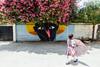 Girl with Umbrella & Campo de la Cruz Graffiti, Atlantico Colombia (AdamCohn) Tags: kmtoin atlantico campodelacruz campodelacruzfantastico colombia bougainvillea geo:lat=10380419 geo:lon=74880632 geotagged graffiti tree atlántico flickrtravelaward