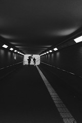happy rainy day (tomorca) Tags: people man bicycle umbrella tunnel dog silhouette xt2 fujifilm