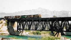 Over The Colorado River AZ/CA (Shot by Newman) Tags: tressle river crossing mountains 6engines railroad bnsf azca daylight afternoon fujifilm fuji400 shotbynewman coloradoriver 35mm old35mmminolta water train