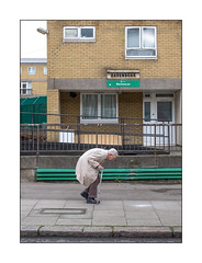 Count Your Blessing's, North West London, England. (Joseph O'Malley64) Tags: man gentleman passerby pensioner oap northwestlondon london england uk britain british greatbritain estate councilestate blockofflats homes dwellings street streetphotography candid humility humanspirit determination character strength inspirational inspiring brickwork bricksmortar cement pointing reinforcedconcrete windows lamp lighting steeluprights meshfencing railings steelrailings ramp incline gradient tarmac pavement accesscover granitekerbing disability mobility access movement endurance signs signage curtains woodenpanels fridge urban urbanlandscape socialdocumentary fujix x100t accuracyprecision
