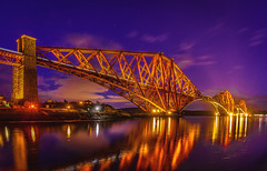 Bridge of Lights (ThePunkyScotsman) Tags: railway bridge train lighttrail longexposure iron reflection coast scotland queensferry edinburgh night