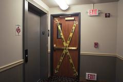 Cuidado (Curtis Gregory Perry) Tags: clatskanie oregon door caution cuidado tape construction painting long exposure elevator hotel motel nikon d810 24mm