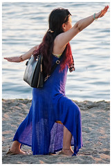 Making the Pose Unique (HereInVancouver) Tags: woman beach water ocean pacific candid portrait vancouverswestend thingstodobythewater canong3x englishbay vancouver bc canada