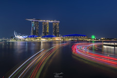 Marina Bay Sands Hotel and Light trails (tapanuth) Tags: singapore marinabaysands hotel resort cityscape bluehour lighttrails night travel photography attraction landmark architecture building asia water reflection marinabay southeastasia tourism skyline business finance downtown famous evening dusk boat transport waterfront