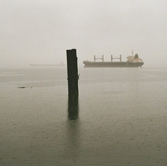 downpour in the bay (losthalo) Tags: rain downpour commencementbay tacoma dim obscured pentaxart itsnotacapture fuji superia800 superia smcpm100mmf28 pentaxm10028 ships shipping danger visibility