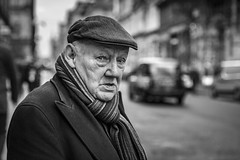 At The Crossing (Leanne Boulton) Tags: portrait people urban street candid portraiture streetphotography candidstreetphotography candidportrait streetportrait eyecontact candideyecontact streetlife old elderly man male face expression look emotion feeling mood atmosphere closeup cap scarf winter tone texture detail depthoffield bokeh naturallight outdoor light shade city scene human life living humanity society culture canon canon5d 5dmkiii 70mm character ef2470mmf28liiusm black white blackwhite bw mono blackandwhite monochrome glasgow scotland uk