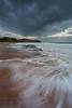 Precarious Position (Xenedis) Tags: australia beach clouds dawn flow morning newsouthwales nsw ocean rocks sand seascape turimetta turimettabeach water sydney