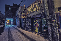 The Alley @ Night (A Great Capture) Tags: toronto art downtown graffiti alley street urban agreatcapture agc wwwagreatcapturecom adjm ash2276 ashleylduffus ald mobilejay jamesmitchell on ontario canada canadian photographer northamerica torontoexplore winter l'hiver city lights night dark nighttime snow neige schnee streetphotography streetscape photography streetphoto streetart efs1018mm 10mm wideangle tiretracks