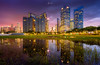 Double Nightscape (keithoys) Tags: purple cityscape skyline downtowndistrict twilight townscape dusk reflection water building park sky sunset golden hour goldenhour bluehour warmlight lights urban longexposure burningsky nature tree marinabay dbsbuildingsingapore singapore landscape nightscape riverbank movingclouds clouds skyscraper