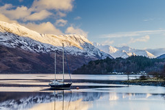 Loch Leven and Glencoe Village (Dougie Milne Photography) Tags: islesofglencoe ballachulish loch leven lake boat morning sunrise mountains snow cold winter snowcappedmountains highlands scotland scottish uk europe dinghy glencoe mamnagualainn hills moored yacht bluesky clouds sunny water landscape nature mountain travel tourism blue scenic beautiful sea view summer sky fjord scenery rock outdoors trees coast tranquil peaceful wintersmorning