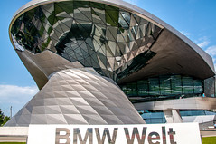 A twist in the tale of a car (Tony Shertila) Tags: bmw bmwmuseum germany bavaria city europe hotel munchen munich outdoor tourist travel welt building architecture reflection twist münchen bayern deu