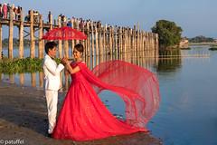 Wedding couple at U Bein Bridge (patuffel) Tags: dress couple wedding teak wood red lady u bein bridge myanmar taungthaman lake amarapura