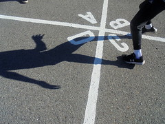 DSC00983 (classroomcamera) Tags: school campus playground playgrounds blacktop concrete floor ground outside outdoors shadow shadows leg legs feet foot shoe shoes sneaker sneakers play plays playing run runs running boy boys child children kid kids move movement motion action sun sunshine sunlight light lights lighting black white paint line lines square squares foursquare a b c d low down angle up above below