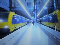 Blue/Yellow Dutch train (JoséDay) Tags: bluegroupsonflickr blueyellow train trainstation delft lagare railwaystation perron1 treinnaardenhaag spiegelingen reflections glasspiegeling spiegelinginglas reflection refletir panasonic panasonictz10 panasonicflickrgroups delftvermeer delftsblauw ikeadelft