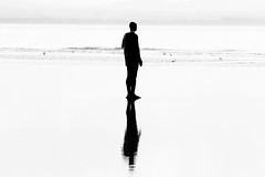 Last man standing (jmiller35) Tags: reflection outdoors canon blackandwhite monochrome silhouette shadow sea water we alone statues liverpool merseside ngc