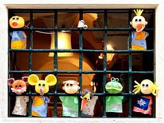 Der Puppenknast - Puppets behind bars...;-) (kurtwolf303) Tags: puppen fenster fenstergitter window funny lustig windowgrille dolls puppets unlimitedphotos cute kurtwolf303 250v10f topf25