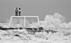 Couple Statue - B&W Waves (Gilli8888) Tags: northumberland newbigginbythesea newbiggin northsea northeast seaside coast coastal winter nikon p900 coolpix waves blackandwhite sea seascape couplestatue statue sculpture art publicart seaspray water yabbadabbadoo