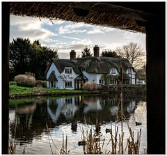 Down by the pond (Hugh Stanton) Tags: water pond cottage thatched reflection
