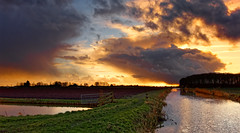 The Mixed Zone (Alfred Grupstra) Tags: nature sunset landscape water reflection sky dusk outdoors ruralscene cloudsky scenics river summer sunrisedawn sun beautyinnature sunlight lake blue agriculture