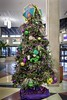 Mardi Gras Christmas tree decorated with purple (justice), green (faith), gold (power) ornaments in the Mobile, Alabama Regional Airport. (thstrand) Tags: southeast southeastern south southernstate us usa unitedstatesofamerica alabama mobile winter destinations traveldestination traditions traditional tradition tourism symbols symbol seasonal season religious religion color purplegoldgreencolors pinetrees public ornamental ornaments ornament nobody christmastree mardigras indoors lent holidayholidays festive festival fattuesday epiphany decorativedisplay decoration decorations decorated customs custom culturalheritage colorful christian celebrations brightcolors carnival annualcelebration airportlobby american