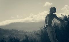 Emboldened valleys (Coisroux) Tags: sculpture valley monochrome misty fog serene embolden dramatic artists deliaregraff stellenbosch d5500 nikond calm landscape clouds mountains humanity fields skyline trees