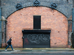I-x-x-x-I (Peter.Bartlett) Tags: manchester ricohgr unitedkingdom brick facade doorway drainpipe colour lunaphoto shutter urban wall candid uk walking urbanarte bag man streetphotography sign graffiti city door england gb