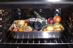 P1010294A (Cecilia Temperli) Tags: stickyshutter nikonfm3a ovenbaked bakednikondinner onions carrots garlic rosemary panasoniclumixlx7 bakednikonfm3a