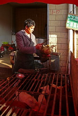 The Art of Killing a Chicken with Two Hands (Wolfgang Bazer) Tags: chicken huhn market markt kunming yunnan poulterer poultry geflügel china suburb vorstadt