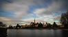 White clouds drift on an on (gorelin) Tags: sony sonya7 fe28f20 ilce7m2 28mm czech czechia nymburk sky skies longexposure oldtown lake water trees tree