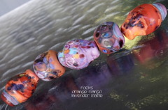 Rocks Orange Mango Lavender Matte (Laura Blanck Openstudio) Tags: openstudio openstudiobeads handmade glass lampwork beads set murano rocks faceted nuggets pebbles stones whimsical funky odd colorful multicolor abstract asymmetric earthy organic speckles frit matte glow opaque etched frosted made usa fine arts art artisan lilac lavender plum eggplant grape violet purple mauve orchid copper green orange coral mango ocher yellow maize aqua turquoise blue burgundy bold maroon sienna brick roof