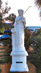 St. Armand's Circle Meter Maid (ThePolaroidGuy / My 3rd. Eye) Tags: srq sarasota florida starmandscircle ed edward drake masterphotographer edwarddrakemfa kingedward thepolaroidguy metermaid shell statue ladybug painted pole rod chalk yellow white roses flowers funny ironic irony sarcastic starmandskey lidokey plants green multch red hiddenitems hiddeninplainsight nude naked toga erotic breasts golfclub parking sensual female hard naturallight availablelight daylight cityofsarasota island