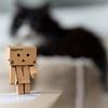 Danbo wasn't sure why he felt a sudden chill (hehaden (away for a week or so)) Tags: cat blackandwhite tuxedo semilonghair catbed bokeh danbo robot cardboardbox amazon square