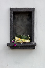 After everyone had left (A Different Perspective) Tags: bali alcove bali365 bamboo flower green leaf offering pink rough temple texture tray wall yellow