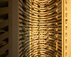 Pear Bank Interior (Scintt) Tags: singapore interior contrast directional sunset golden orange warm yellow architecture building structure lines curve facade dramatic surreal abstract design old historical history construction modernist brutalist light glow sun afternoon wideangle nikon 1424 panorama stitched condominium private property residential estate apartments flats homes housing living space enbloc urban exploration modern scintillation scintt jonchiangphotography outram chinatown pearlbank stairwells balcony windows walls concrete corridor circular