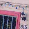 house of blue lights (msdonnalee) Tags: window janela fenster finestra fenêtre ventana stringoflights lightfixture