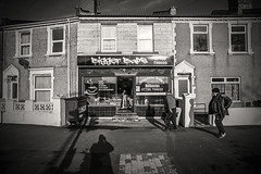 The bigger the better..... (Dafydd Penguin) Tags: big baps bigger biggest bap bristol sign shop sandwich bar cafe downtown west country england city urban street shot candid people scene life blackandwhite blackwhite black white bw monochrome mono raw leica m10 elmarit m 21mm f28