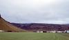 Farm Under Eyjafjallajökull (bellemarematt) Tags: 200 elitechrome kodak n80 nikon nikonn80 kodakelitechrome200 iceland travel honeymoon analog film eyjafjallajökull farm