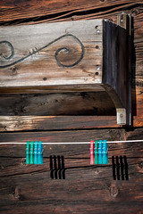 Colors on a line (cs_one) Tags: wood surface pattern building winter wooden old textured switzerland retro vintage rough valais timber design box exterior detail clothespeg oberwald brown peg aged house weathered goms ancient antique europe rustic clothespin