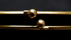 Evening purse clasp (Monceau) Tags: clasp eveningbag gold balls black silk fasteners macromondays lines minimal macro