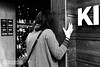 KI (wanderandclick) Tags: fujifilmx asia travel fujifilmx100f china x100f city hongkong hongkongsar travelling holiday fujifilm kowloon hk people acros contrast grip shop woman back hand sign blackandwhite behind