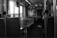 Spirits Of El.jpg (Milosh Kosanovich) Tags: chicagophotoart vintagefilm epsonv750pro chicagophotographicart chicago minoltax700 mickchgo kodaktmaxrsdeveloper miloshkosanovich film kodaktmax100 bwfilm emptyelcar chicagophotographicartscom ctal cta
