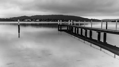 Overcast Morning by the Bay - Waterscape (Merrillie) Tags: daybreak woywoy sunrise nature bay reflections overcast foreshore newsouthwales clouds earlymorning nsw brisbanewater australia blackandwhite monochrome landscape morning coastal water outdoors waterscape cloudy centralcoast sky dawn wharf