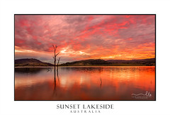 Sunset lake side (sugarbellaleah) Tags: clouds sunset lake rural outback water reflections red vivid gorgeous landscape surreal mountains hills deadtrees ripples tranquil lonely serene remote season sunlight shadow trees treetrunk mirror travel tourism vacation holiday campground stunning sensational