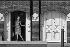 Hiya! (Sean Sweeney, UK) Tags: brighton east sussex england uk beach town seafront nikon dslr d810 black white monochrome bw dummy doors storefront mannequin dress model arches bricks symmetry lockup