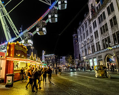 Funfair Dam Square Amsterdam. (James- Burke) Tags: amsterdam atmosphere atmospheric bigwheel candid damsquare ferriswheel funfairs holland netherlands nightphotography people scenic street