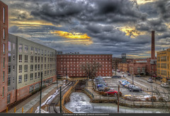 Lowell, MA. (Pearce Levrais Photography) Tags: building architecture city sunrise cloud canal landscape cityscape dramatic railroad tracks mill chimney historic frozen water system