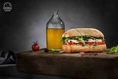 Sandwich with tomato and mozzarella on dark background (Food photography / Food styling) Tags: appetizer baguette bap basil basilikum bio bun cheese closeup cuisine cut decorated decoration diet eat enjoy flavor focaccia food foodstuff freetime fresh green health healthy isoliert italian leaf lowfat meal mozzarella oliveoil olives organic panini red salad salat sandwich served slice snack starter summer tomate tomato vegetable vegetarian white