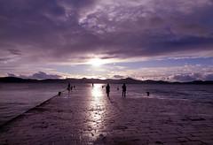 After the rain (Elvis L.) Tags: sun sunset sky clouds sea water humans people adriatic dalmatia croatia zadar pier dock stone slabs landscape port channel island ugljan