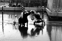 After the fall (pascalcolin1) Tags: paris femme woman children enfants pluie rain reflets reflection chute fall photoderue streetview urbanarte noiretblanc blackandwhite photopascalcolin canon canon50mm 5omm